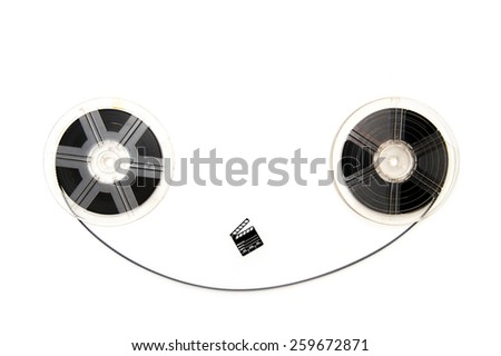 Two vintage 8mm reels horizontally connected with film and a little clapper board isolated on white background - stock photo