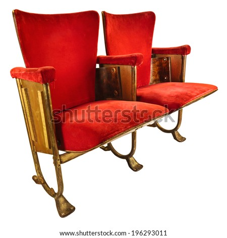 Two vintage red movie theater chairs isolated on a white background - stock photo