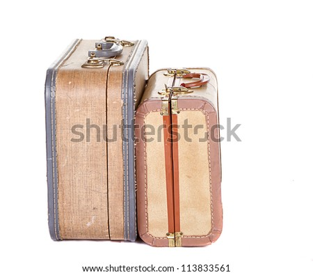 Two vintage suitcases closed on their sides isolated on white - stock photo