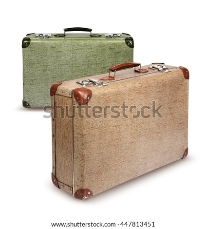 Two vintage suitcases front left isolated on white - stock photo