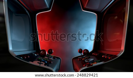 Two vintage unbranded arcade games with a joysticks and buttons and a blank screen opposing each other lit by contrasting colour schemes on a dark ominous background with copy space - stock photo