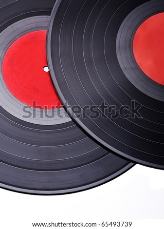 Two vintage vinyl records with red label, closeup - stock photo