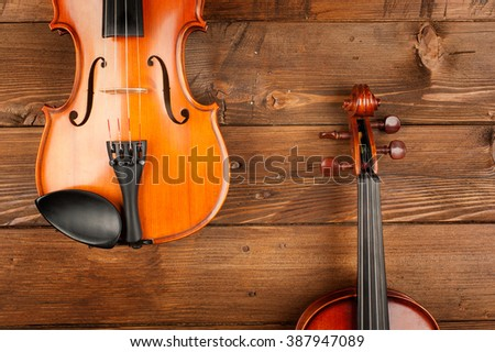 two violins in wood background - stock photo