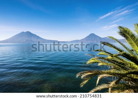 Two volcanoes on the beautiful lake - stock photo