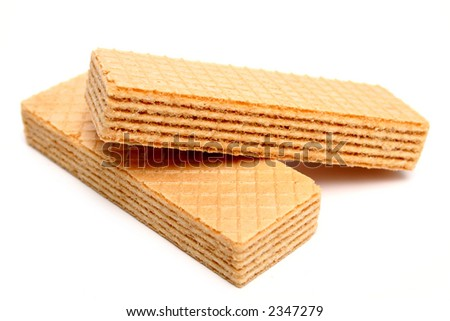 Two wafers with a vanilla cream macro - stock photo
