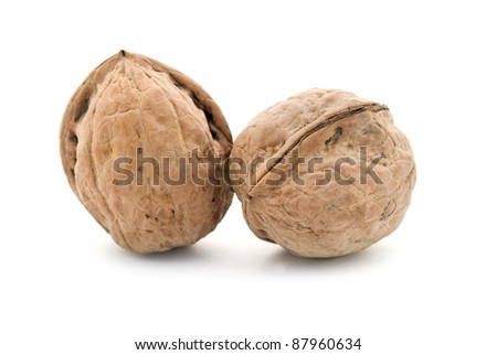 two walnuts are isolated on a white background