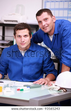 Two warehouse workers taking inventory - stock photo