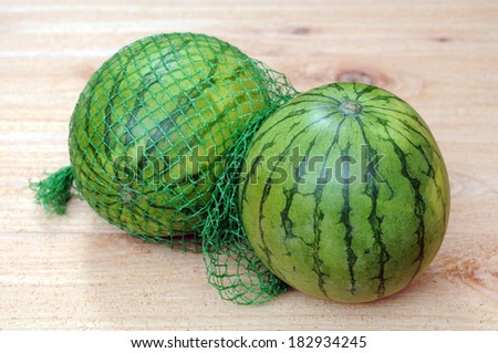 two water melons on wooden table  - stock photo