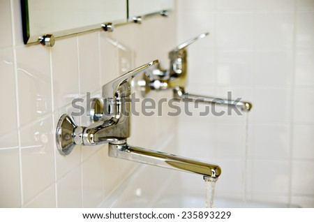 two water taps in the bathroom - stock photo