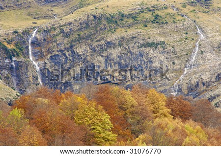 Two waterfalls and forest in Pyrenees