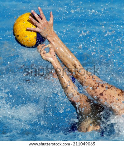 Two waterpolo players in actions during a match - stock photo