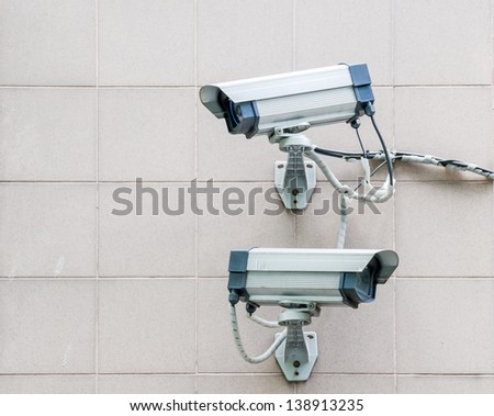 two way cctv on the wall - stock photo