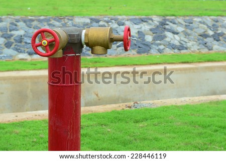 two way fire hose valve in park - stock photo