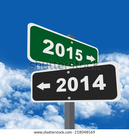 Two Way Street Sign Pointing to 2014 Or 2015 in Blue Sky Background - stock photo