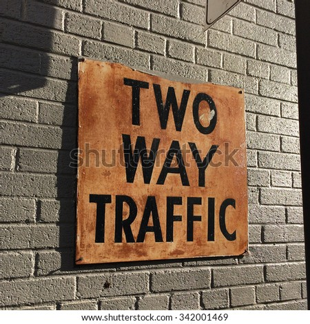 two way traffic sign on building - stock photo