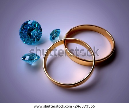Two wedding rings and blue gems on the dark background - stock photo