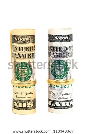 Two wedding rings and money as symbol for an expensive alliance