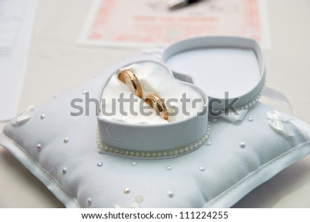 Two wedding rings in a heart-shaped box - stock photo