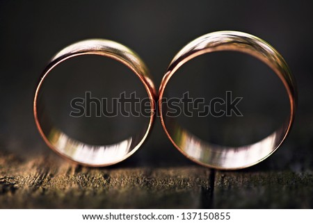 Two wedding rings in infinity sign. Love concept. Very small dept of field. - stock photo