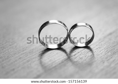 Two wedding rings in infinity sign. Love concept. Very small depth. - stock photo
