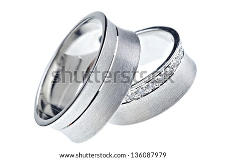 Two wedding rings isolated on white background - stock photo