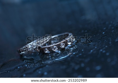 two wedding rings on a blue background. - stock photo