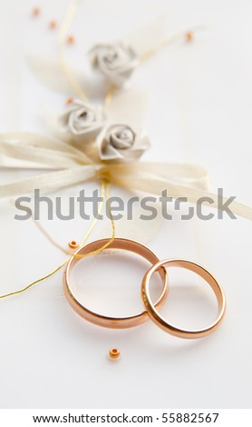 Two wedding rings with greeting card - stock photo