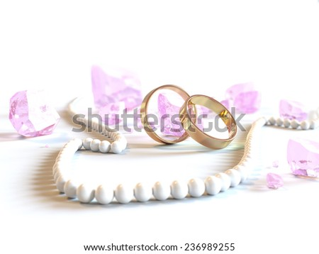 two wedding rings with white bead and pink gemstones - stock photo