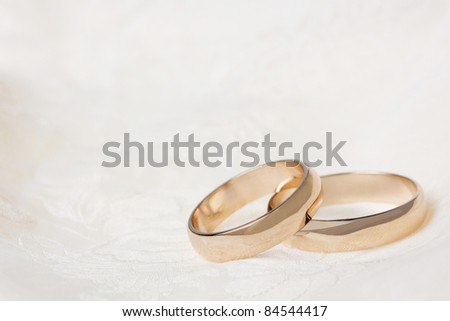 Two  weddings rings on a background a fabric - stock photo