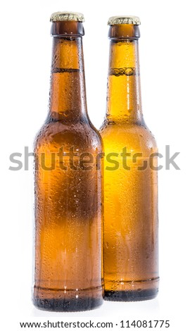 Two wet bottles of Beer isolated on white background - stock photo