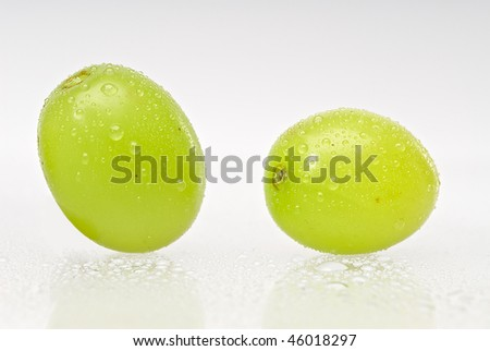 Two wet green grapes isolated on white background - stock photo