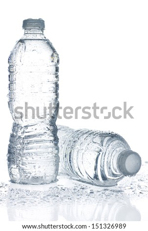 Two wet water bottles on white background with copy space. - stock photo