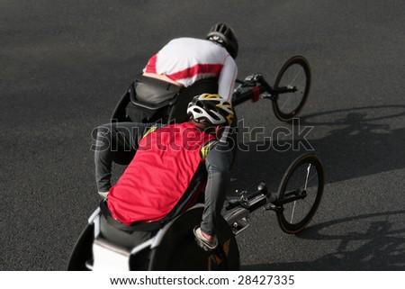 two wheelchair athletes during a marathon - stock photo
