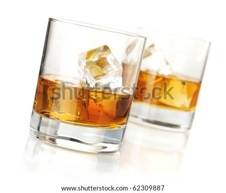 Two whiskey glasses. Isolated on white with reflection - stock photo