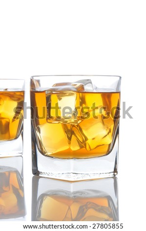 Two Whiskey Glasses isolated on white with reflections and copyspace