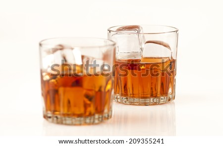 Two whisky glasses on white