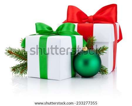Two White boxs tied red and green ribbons bow, pine tree branch and christmas ball Isolated on white background - stock photo