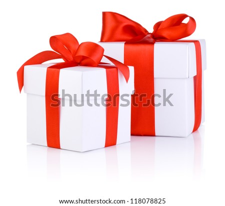 Two White boxs tied with a red satin ribbon bow Isolated on white background - stock photo