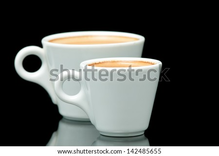 two white coffe cups on the black background - stock photo