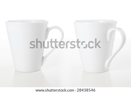 Two white coffee mugs isolated over a white background.