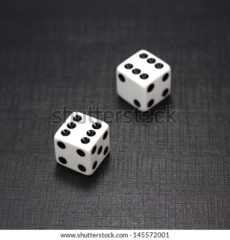 Two white dices on a black background - stock photo