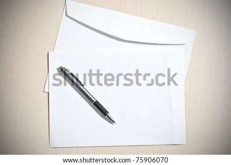 Two white envelopes with pen - stock photo