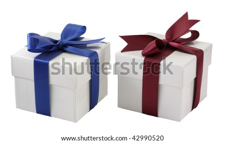 two white gift boxes with red and blue bows on a white background