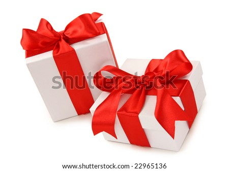 Two white gift boxes with red ribbon isolated on white background