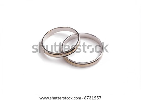 two white gold wedding rings touching each other