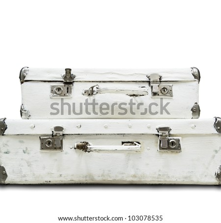 Two white old suitcase isolated from background - stock photo