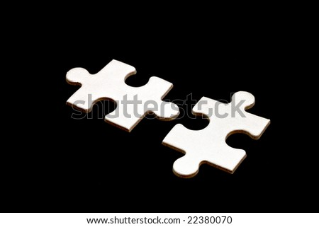 Two white puzzle black background isolate. - stock photo