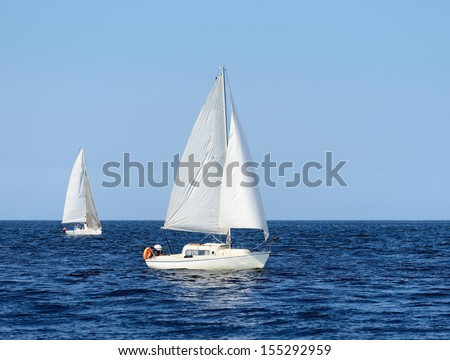 two white sail yachts sailing. Riga, Latvia - stock photo