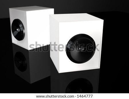 Two white speakers on black background