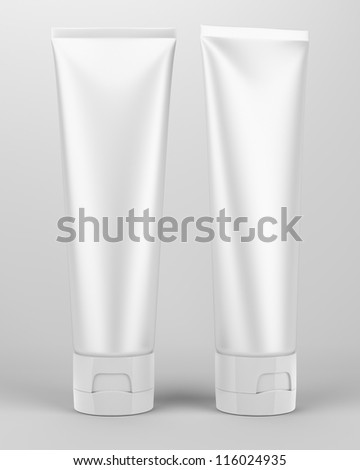 Two white tubes with isolated on gray - stock photo